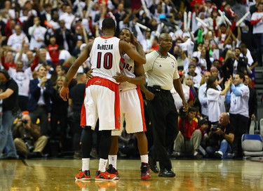 DeMar DeRozan and Kyle Lowry of the Toronto Raptors celebrate the win over the Atlanta Hawks during the season opener NBA action at the Air Canada Centre in Toronto, Ont. on Wednesday October 29, 2014. Dave Abel/Toronto Sun/QMI Agency