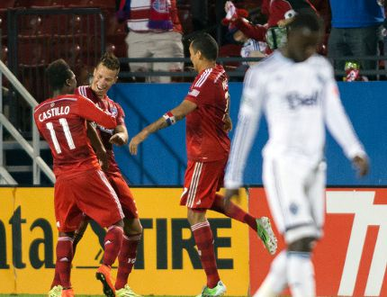 Kekuta Manneh walks away while FC Dallas celebrates Michel's go-ahead goal in a 2-1 win over the Vancouver Whitecaps. REUTERS