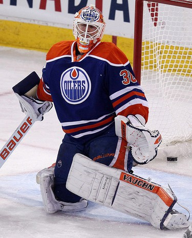 The Edmonton Oilers' goalie Ben Scrivens (30) reacts after  the Nashville Predators' second goal during second period NHL action at Rexall Place, in Edmonton Alta., on Wednesday Oct. 29, 2014. David Bloom/Edmonton Sun/QMI Agency