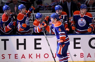 Taylor Hall (4) and the Edmonton Oilers celebrates Halls' goal against the Nashville Predators during third period NHL action at Rexall Place, in Edmonton Alta., on Wednesday Oct. 29, 2014. David Bloom/Edmonton Sun/QMI Agency
