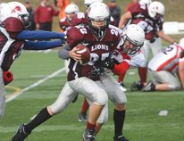 Bantam Lions quarterback Jackson McLean evades an Falcons defender with help of Jack Staddon during last Saturday's semifinal match. The Lions season came to an end at the hands of the Falcons.
