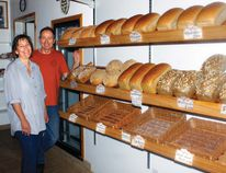 Eva and Bernhard Fortner pose with their baking goods on the last day of operation at their store, Bernies Bavarian Bakery, who has fed loyal residents for the past 16 years in Cochrane and are now moving back to Germany and will be sorely missed.