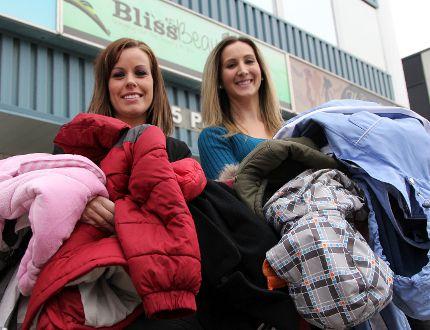 Lisa Lachapelle, left, an esthetician with Bliss Beauty Bar, and Kim Sulatycky, the business owner, say they will have volunteers accepting donated winter coats, hats, mitts and boots along the Timmins Santa Claus parade route on Saturday, Nov. 8. The clean and gently used items will be collected and donated to a number of local charitable organizations including Timmins & Area Women In Crisis and the Good Samaritan Inn homeless s