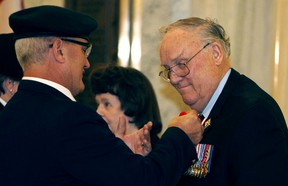 His Honour, Col. (Ret'd) the Honourable Donald S. Ethell gets a poppy pinned on his jacket during the poppy ceremony at the Alberta Legislature in Edmonton, Alberta on Thursday, October 30, 2014. Perry Mah/Edmonton Sun/QMI Agency