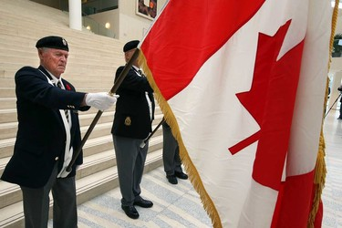 A Legion honour guard stands at attention during speeches at the poppy ceremony at the Alberta Legislature in Edmonton, Alberta on Thursday, October 30, 2014. Perry Mah/Edmonton Sun/QMI Agency