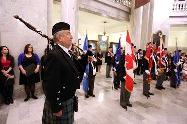 Honour guards stand at attention during the poppy ceremony at the Alberta Legislature in Edmonton, Alberta on Thursday, October 30, 2014. Perry Mah/Edmonton Sun/QMI Agency
