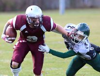 Frontenac Falcons' Dustin Brogaard gets away from Holy Cross Crusaders' Justus Masucol during Kingston Area senior AAA football semifinal action at Holy Cross on Thursday. (IAN MACALPINE/THE WHIG-STANDARD)