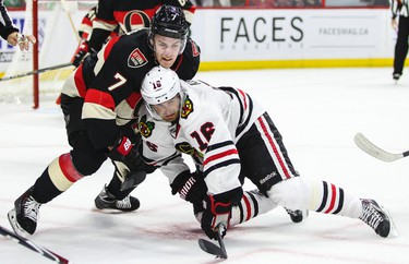 Ottawa Senators' Kyle Turris battles with Chicago Blackhawks' Marcus Kruger after the faceoff during NHL hockey action at the Canadian Tire Centre in Ottawa, Ontario on Thursday October 30, 2014. Errol McGihon/Ottawa Sun/QMI Agency