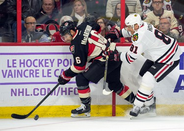 Oct 30, 2014; Ottawa, Ontario, CAN;  Ottawa Senators left wing Clarke MacArthur (16) skates with the puck in front of Chicago Blackhawks right wing Marian Hossa (81) in the first period at the Canadian Tire Centre. Mandatory Credit: Marc DesRosiers-USA TODAY Sports