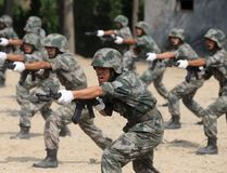 Members of People's Liberation Army (PLA) coastal defence force shout as they practise during a drill to mark the upcoming 87th Army Day at a military base in Qingdao, Shandong province July 29, 2014. (REUTERS/Stringer)
