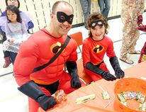 Elgin Market Public School hosted hundreds of students from across Kincardine for its annual Halloween Party on Oct. 23, 2014. Students and parents were welcome to show off their costumes before Halloween and take part in a number of games and activities organized by the Elgin Market and Huron Heights Home and School Association. The Incredibles father-daughter duo of Jason and Gabrielle Geberdt had fun with the popsicle stick puzzle. (TROY PATTERSON/KINCARDINE NEWS)