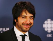 Jian Ghomeshi arrives on the red carpet at the 2014 Canadian Screen awards in Toronto, March 9, 2014. (Reuters)