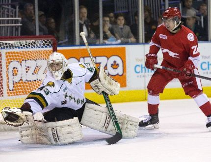 London Knights goalie Michael Giugovaz makes a glove save in front of Sault Ste. Marie Greyhound Sergey Tolchinsky in the first period of their Ontario Hockey League at Budweiser Gardens on Friday. (DEREK RUTTAN, The London Free Press)