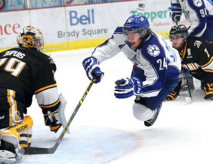 Sudbury Wolves' Evan de Haan goes airborne in front of the Sarnia Sting goal during OHL action at Sudbury Community Arena on Saturday night.