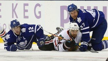 Leafs' Leo Komarov  takes down Blackhawks'  Michal Rozsival. Toronto Maple Leafs vs the Chicago Black hawks at the Air Canada Centre in Toronto on Saturday November 1, 2014. Craig Robertson/Toronto Sun/QMI Agency