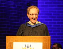 Ben Leeson/The Sudbury Star In this file photo, former Sudbury MPP and mayor Jim Gordon shares a laugh with the audience after receiving an honourary doctorate of laws from Laurentian University during a convocation ceremony in the Fraser Auditorium.