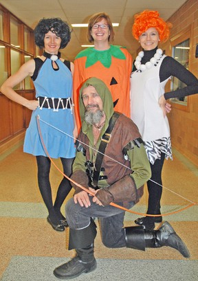 Students and staff at Mitchell District High School (MDHS) got into the spirit of Halloween last Friday, Oct. 31, dressing in costumes for the day. Staff took a moment to show off, including Principal Emma Bannerman (left), EA Jacquie Mohr, Vice-Principal Kim Crawford and Physical Education teacher Bob Ellison. The question is – did they receive any treats from the students? KRISTINE JEAN/MITCHELL ADVOCATE