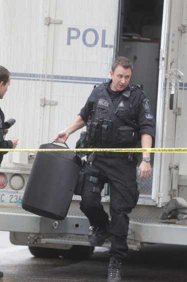 Winnipeg police evacuated a hotel in downtown Winnipeg after a device was found.  The bomb unit was on scene for several hours.   Tuesday, November 4, 2014.  Chris Procaylo/Winnipeg Sun/QMI Agency