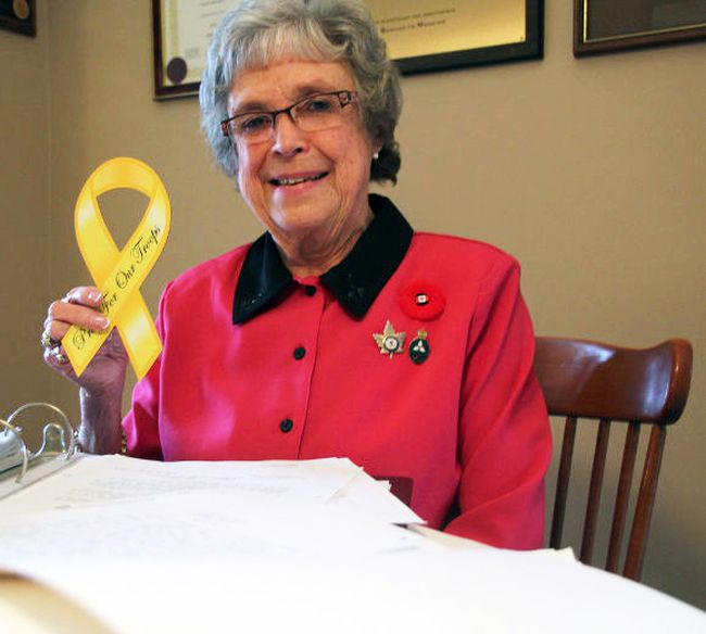Wilma McNeill, pictured here with decades of letters, has fought for 25 years to return Remembrance Day to the status of a statutory holiday across Canada. (BARBARA SIMPSON/QMI Agency)
