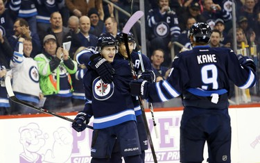 Winnipeg Jets forward Mark Scheifele (55) celebrates with teammates after he scores on Nashville Predators goalie Carter Hutton (30) (not shown) during the first period at MTS Centre.