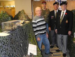 "Paul DeFoort of the Multicultural Heritage Association of Norfolk, military historian Robin Barker-James, Delhi Legion member Ron VanLeuvenhage and Delhi Legion president Ed Bouw stand in an artistic presentation of a trench system which is a part of ""The Great War Centennial Exhibit"" located in a storefront on Main Street in Delhi. SARAH DOKTOR/Simcoe Reformer"