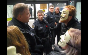 Police and protesters squared off at London city hall Wednesday night. The demonstrators were part of the Million Mask March.