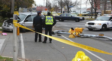 Police at the scene after a woman was struck and killed by a minivan Thursday, Nov. 6, 2014 at Midland Ave. and Gilder Rd. (Veronica Henri/Toronto Sun)