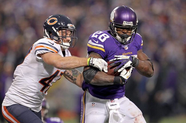 Minnesota Vikings running back Adrian Peterson (28) is tackled by Chicago Bears safety Chris Conte (47) during NFL action at Mall of America Field. (Brace Hemmelgarn/USA TODAY Sports)
