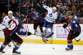 Jarome Iginla of the Avalanche puts a hit on James van Riemsdyk of the Maple Leafs during the first period in Denver on Thursday night. (Doug Pensinger/Getty Images/AFP)