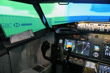 AeroSim Experience, a flight simulation centre that recently opened its doors in Laval, Que., offers people the chance to fly a virtual plane using flight simulator software running inside a replica of a Boeing 737 cockpit. (PATRICE BERNIER/QMI Agency)