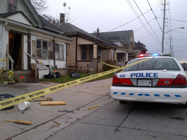 Police at the scene of a double stabbing on Adelaide Street North, in the early morning hours of Nov. 9, 2014. (DALE CARRUTHERS, Free Press file photo)