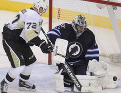 Jets goalie Ondrej Pavelec is no fan of the shootouts. Maybe he'll face a lot less of them if the NHL adopts the three-on-three overtime now on trial in the AHL. >Brian Donogh/Winnipeg Sun/QMI Agency