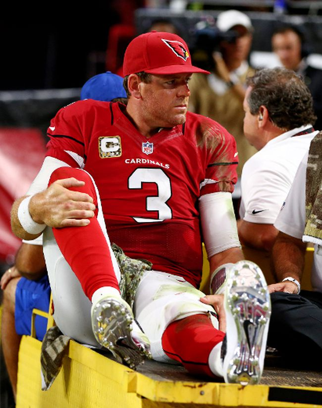 Cardinals QB Carson Palmer reacts as he is taken off the field on a cart after suffering a knee injury duing second half action against the Rams in Phoenix on Sunday. (Mark J. Rebilas/USA TODAY Sports)