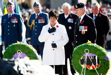 Silver Cross Mother Gisele Michaud pauses after laying a wreath during Remembrance Day ceremonies at the National War Memorial in Ottawa November 11, 2014. Michaud's son, Master Cpl. Charles-Philippe Michaud, 28, died of his injuries after stepping on an improvised explosive device while on patrol near Kandahar City in Afghanistan in 2009. REUTERS/Chris Wattie (CANADA  - Tags: POLITICS MILITARY ANNIVERSARY)