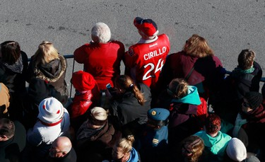 A man wears an Ottawa Sentaors jersey with the name Cirillo on it during Remembrance Day ceremonies at the National War Memorial in Ottawa November 11, 2014. Cpl. Nathan Cirillo was fatally shot October 22, 2014 while guarding the National War Memorial. REUTERS/Blair Gable (CANADA  - Tags: POLITICS MILITARY ANNIVERSARY)