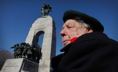 War vet Ted Patrick during a Remembrance Day ceremony at the National War Memorial in Ottawa on Tuesday Nov 11,  2014. Thousands of people gathered at the National War Memorial to take part in the National Remembrance Day Ceremony. Tony Caldwell/Ottawa Sun/QMI Agency