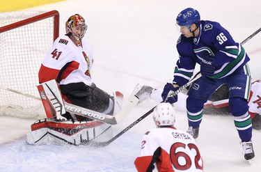 Ottawa Senators' goalie Craig Anderson (left) blocks a shot from Vancouver Canucks� Vancouver Canucks� Jannik Hansen (right) during the first period of NHL game at Rogers Arena in Vancouver, B.C. on Tuesday November 11, 2014. Carmine Marinelli/QMI Agency