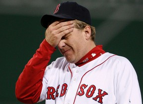 Boston Red Sox pitcher Curt Schilling reacts after giving up a home run to the Cleveland Indians during the ALCS playoffs in Boston, in this October 13, 2007 file photo. (REUTERS/Brian Snyder/Files)