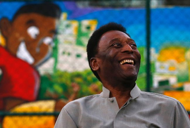 Brazilian soccer legend Pele laughs during the inauguration of a refurbished soccer field at the Mineira slum in Rio de Janeiro September 10, 2014. (REUTERS/Ricardo Moraes)