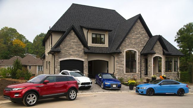 The Dream Lottery home at 30-567 Rosecliffe Terrace in London is the backdrop for some of the cars available as prizes including a Range Rover, Porsche Cayenne, Audi A5S and a BMW M-series. (MIKE HENSEN, The London Free Press)