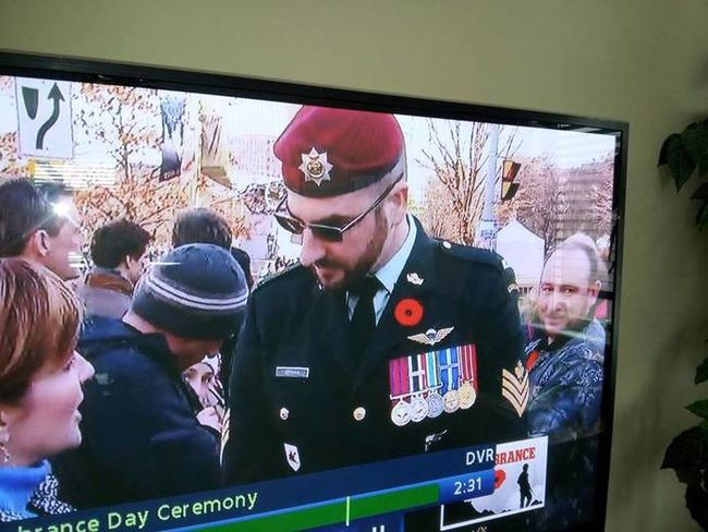 <p>A uniformed man using the name Franck Gervais is interviewed by CBC during Tuesday's Remembrance Day ceremony at the National War Memorial in Ottawa.  CBC SCREEN GRAB/SUPPLIED