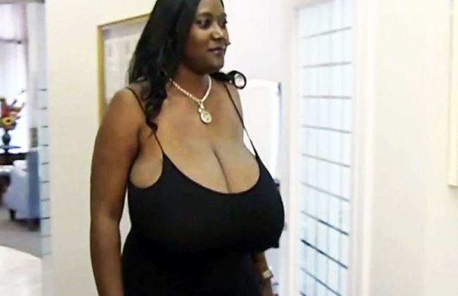 Kerisha Mark suffered a rare hormonal condition that caused her breasts to balloon in her 30s. (YouTube)