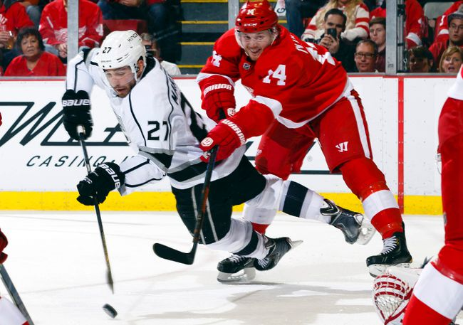 Los Angeles Kings defenceman Alec Martinez scores while being defended by Detroit Red Wings centre Gustav Nyquist (14) in the second period at Joe Louis Arena. (Rick Osentoski/USA TODAY Sports)