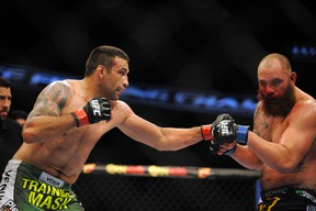 Fabricio Werdum (red gloves) fights Travis Browne (blue gloves) before their heavyweight fight during UFC on FOX 11 at Amway Center on April 19, 2014. (David Manning/USA TODAY Sports)