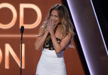 """Presenter Jennifer Lopez reacts after flubbing a line as she introduces the winner of the Hollywood Animation Award, the creators of """"How to Train Your Dragon 2,"""" during the Hollywood Film Awards in Hollywood, California November 14, 2014.   REUTERS/Kevork Djansezian"""