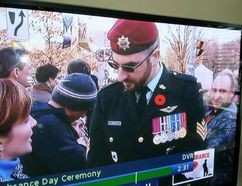 A uniformed man using the name Franck Gervais is interviewed by CBC during Tuesday's Remembrance Day ceremony at the National War Memorial in Ottawa. (CBC SCREEN GRAB/SUPPLIED)