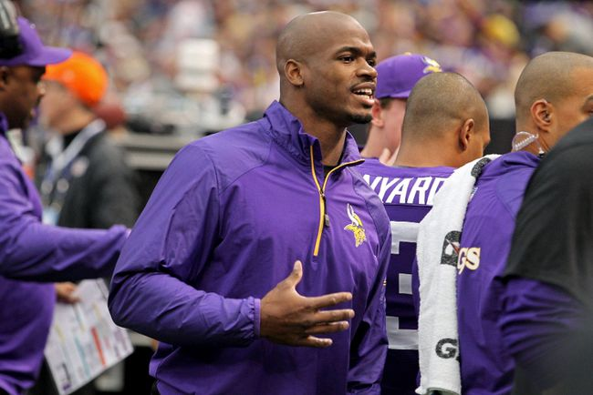 Minnesota Vikings running back Adrian Peterson (28) talks on the sidelines during the first quarter against the Philadelphia Eagles in Minneapolis, Minnesota in this file photo from December 14, 2013. (REUTERS)