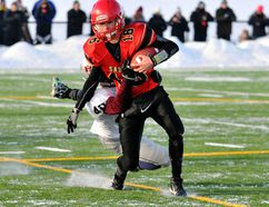 Rylee Peters of the Sexsmith Sabres, is tackled by a Holy Rosary Raider during the Football Alberta Tier IV North Finals at the Community Knowledge Campus Field on Saturday, The Raiders won 48-13 and advance to the Tier IV provincial championship in Lethbridge, on November 21. Logan Clow/Daily Herald-Tribune