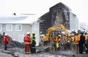 Emergency workers dig through the remains on the site of the Residence du Havre in L'Isle Verte, Quebec, January 28, 2014. REUTERS/Mathieu Belanger