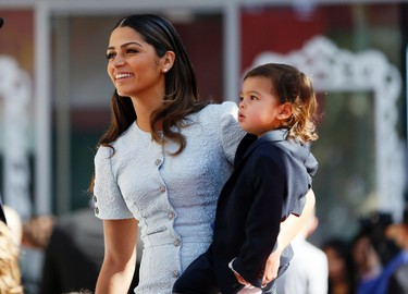 Model Camila Alves, wife of actor Matthew McConaughey, arrives with their son Livingston (R) for a ceremony honoring him with the 2,534th star on the Hollywood Walk of Fame in Hollywood, California November 17, 2014. REUTERS/Danny Moloshok   (UNITED STATES - Tags: ENTERTAINMENT)